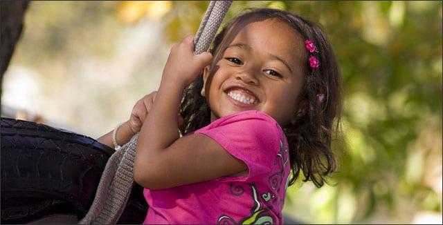 Backyard play ideas - little girl on tire swing